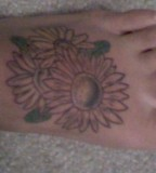 Nice Daisy Flower Tattoo Design on Feet for Women - Flower Tattoos