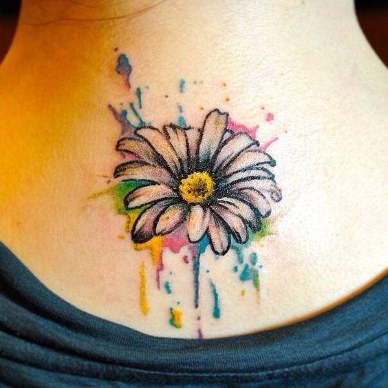 Daisy watercolor tattoo