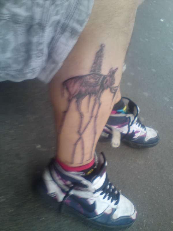 Beautiful Salvador Dali Elephant Tattoo on Men Leg