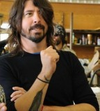 Dave Grohl's Feather Tattoo On His Left Forearm