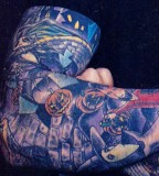 Close-Up View of Davey Havok's Right Arm Tattoos
