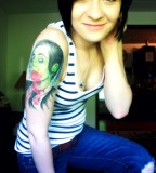 Davey Havok Of AFI Zombified Tattoo on Girl's Upper Arm
