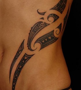 delicate ribcage tribal tattoo
