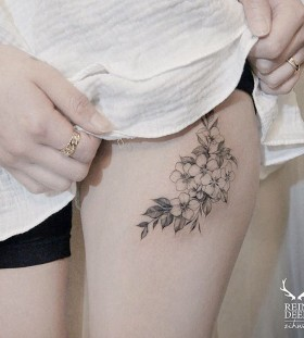 delicate-upper-thigh-flower-tattoo