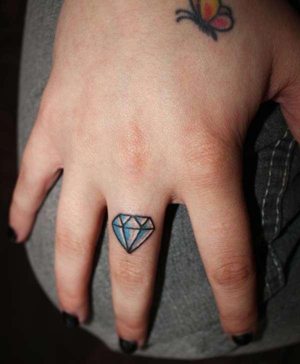 Cute Small Diamond Girls Tattoo on Finger