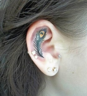 ear feather tattoo