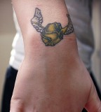 Cool Harry Potter Wings Symbol Tattoo on Upper Wrist