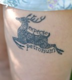 Cool Expecto Patronum Spell with Swirly Design Running Deer Tattoo on Thigh