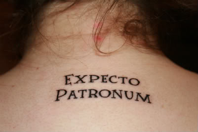 Awesome Lettering Harry Potter Spell Expecto Patronum Tattoo on Women Upper Back
