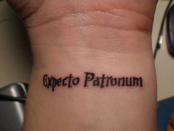 Simple Expecto Patronum Tattoo Design on Wrist Close-Up View