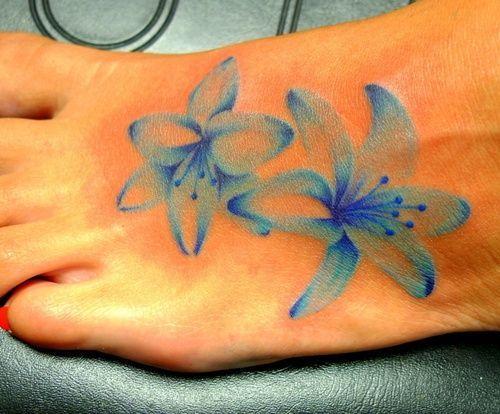 faded blue flower tattoo