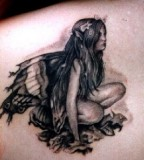 Black and White Fairy Shaped Tattoo Design