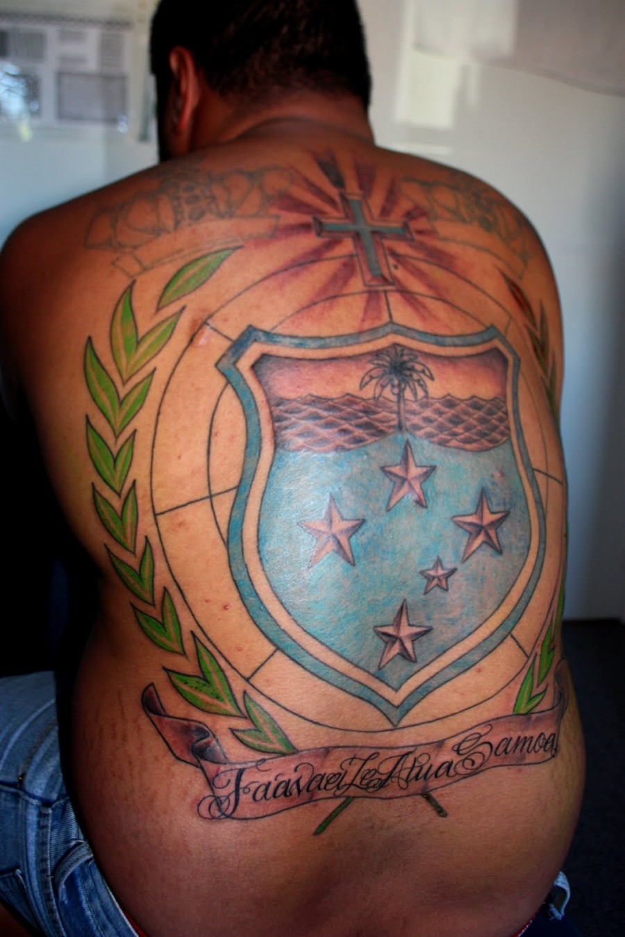 Awesome Full Back Cross and Logo Tattoo Design for Men