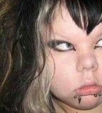 Funny Fat Emo Girl with Chic Tattoos at Face