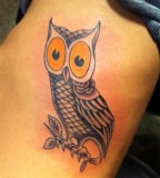 Owl on Feather Arm Tattoo