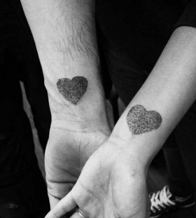 fingerprint hearts couple tattoo