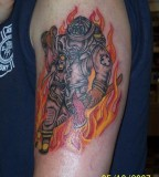 Firefighter Rescueing A Child Firefighter Tattoo
