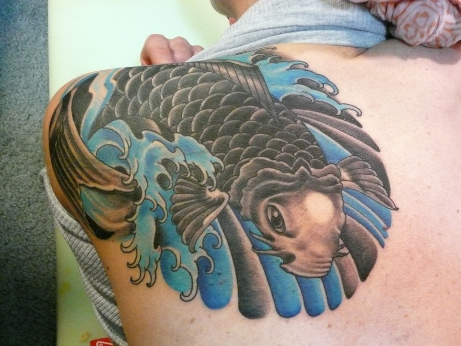 Awesome Flying Fish Tattoo On Upper Back
