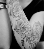 Flower Tattoo Design on Arm for Women