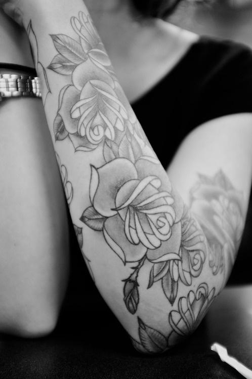 Flower Tattoo Design on Arm for Women