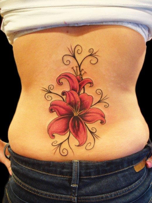 Lower Back Lily Tattoo Designs for Women