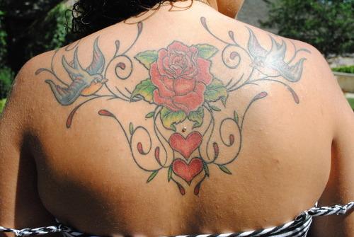 Beautiful Flower Tattoo Design on Back for Women