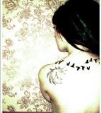 Amazing Imaginative Flying Bird Silhouette Tattoo