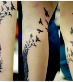 Cool Feather Flying Bird Silhouette Leg Tattoo