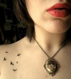 Flying Bird Silhouette Tattoo On Girl Shoulder