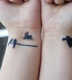 Nice Flying Birds Silhouette Tattoo Image On Wrist