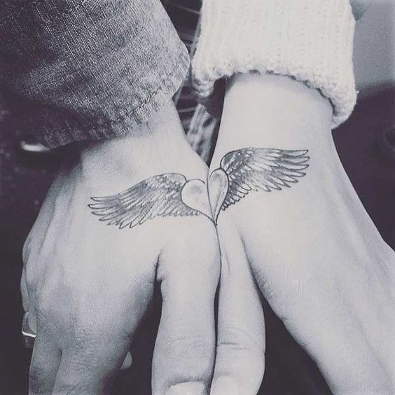 flying heart couple tattoo