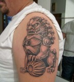 Foo Dog Upper Arm Tattoo Design For Men