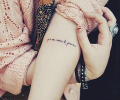 Quotes Tattoo on Upperarm