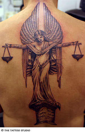 Fancy Libra Tattoo Design On The Upper Back