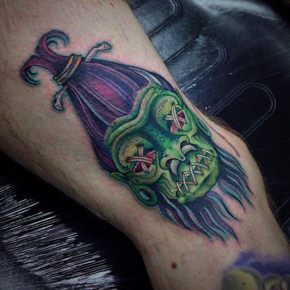 green voodoo tattoo