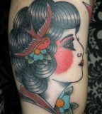 Gypsy Women with Black Curly Hair and Swallow Ornament Tattoos on Arm