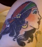 Gypsy Chubby Women Head Tattoo on Outer Calf