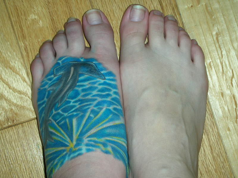 Colored Imaginative Hammerhead Shark Tattoo On Left Foot