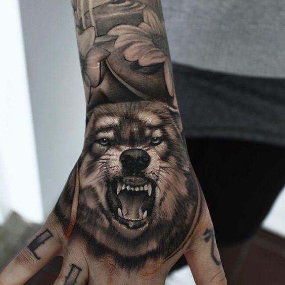 hand-wolf-tattoos