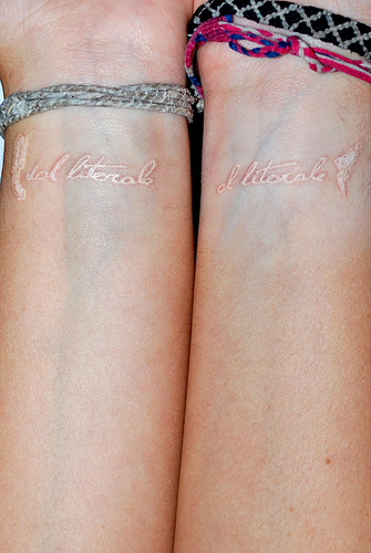 Cuople White Same White Ink Tattoo Design
