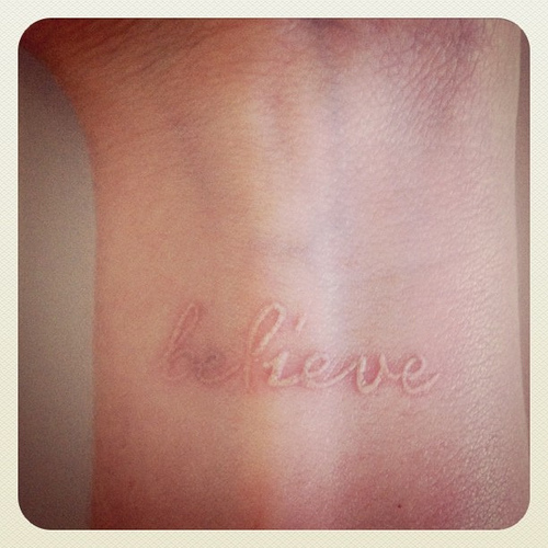 Believe Word White Ink Tattoo