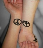 Peace Symbol Tattoos On Wrists