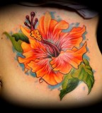 Hibiscus Flower On Ribs Tattoo Ideas