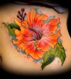 Hibiscus Flower On Ribs Tattoo Ideas