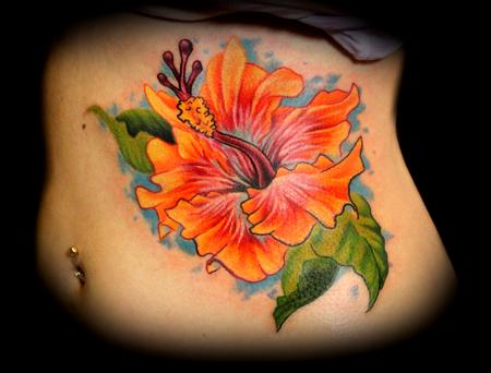 Hibiscus Flower On Ribs Tattoo Ideas Tattoomagz Tattoo Designs