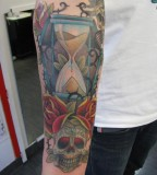 Hourglass with Crowned Skull tattoo Design