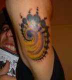 Spiral Tattoo Desogn On Tricep
