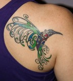 Designing Hummingbird Upper Back Tattoo