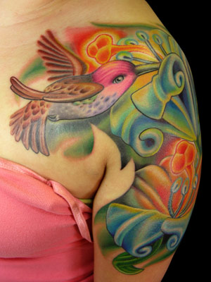 Gorgeous Tribal Style Design Of Colored Hummingbird And Flowers