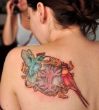 Hummingbirds on Nests Tattoos Design